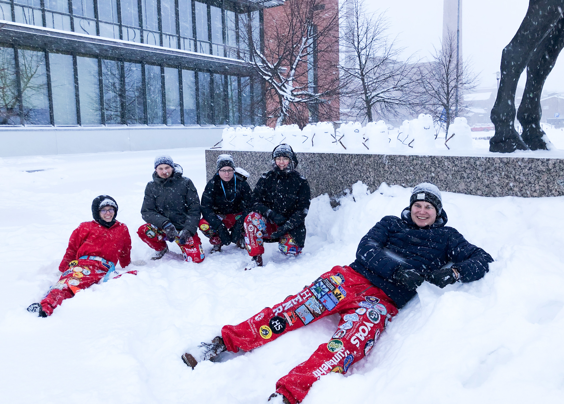 Board of the Student Union in front of snowy Domus Bothnica